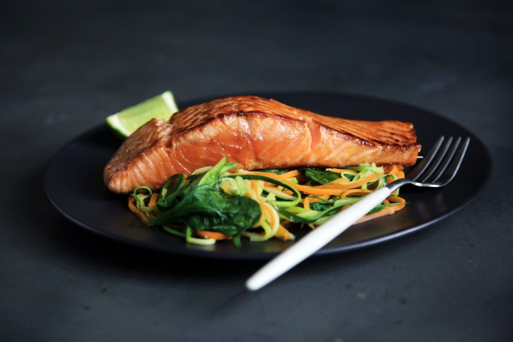 Pan-fried Salmon and Veggies on the side. Salmon contains high amount of Omega 3 Fatty Acids and is also an example of clean protein.